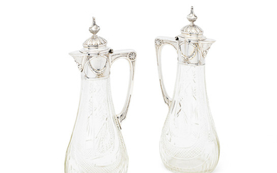 A pair of Russian silver-mounted claret jugs