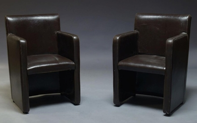 A pair of modern brown leather armchairs, of recent manufacture,...