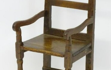 A rare early 18thC mixed wood childs chair, the back