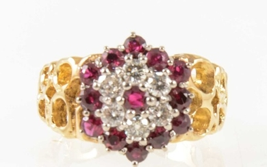 A vintage ruby and diamond circular cluster ring.