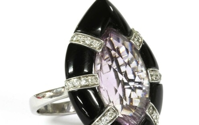 A white gold amethyst, onyx and diamond ring