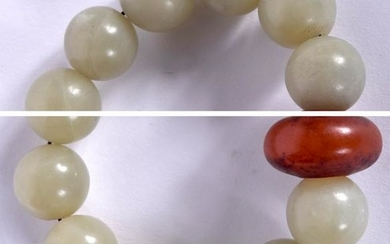 AN EARLY 20TH CENTURY CHINESE JADE SPHERICAL BEAD