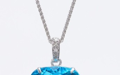 AN IMPRESSIVE TOPAZ PENDANT-The cushion cut blue topaz weighing 100cts, to a diamond set bale, suspended from a fine trace chain, al...