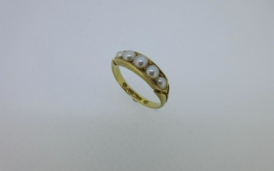 An 18ct gold pearl set ring,