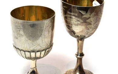 An Edward VII silver trophy-cup and a German silver trophy...