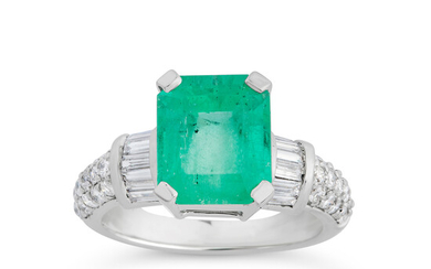 An Emerald, Diamond and White Gold Ring