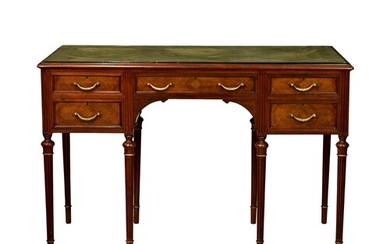 An English Louis XVI style mahogany and parcel gilt dressing...