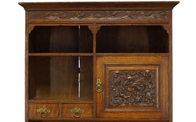 Arthur W. Simpson (1857-1922), an Arts and Crafts carved oak...
