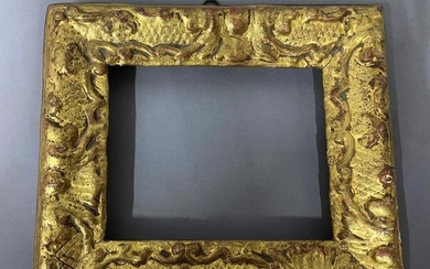 Carved and gilded wood frame with Bérain decoration