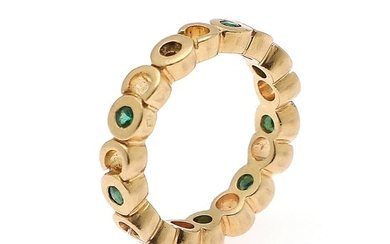 Chanel: An emerald ring set with numerous circular-cut emeralds, mounted in 18k gold. Size 54.