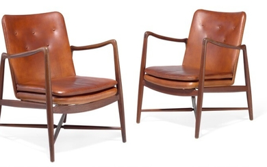 "Finn Juhl: ""Fireplace Chair"". A pair of teak easy chairs. Sides, back and loose seat cushion upholstered with patinated cognac coloured leather. (2)"