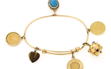Gold charms and precious stones bracelet.
