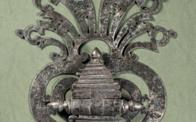 Large wrought-iron knocker decorated with twisted fillets and...