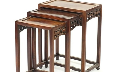 Nest of three Chinese hardwood occasional tables, the