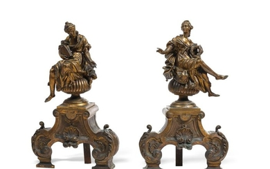 Pair of chased and gilded bronze andirons surmounted...