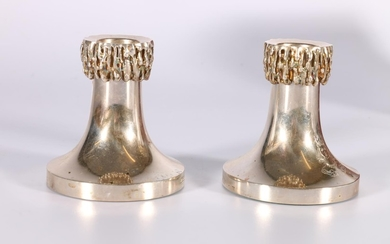 Pair of silver dwarf candlesticks of tapering shape with det...