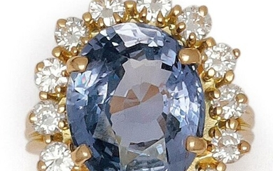 "Ring "" Fleur "" in yellow gold, set with an oval sapphire in a ring of brilliant-cut diamonds. Tour of doigt : 52. P. Brut : 9 g. Total weight of diamants : about 1 carat. Weight of saphir : 8.70 carats. Origine : Ceylon. It is accompanied by a..."