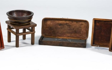 """SEVEN CHINESE WOODEN VESSELS AND A SMALL FOOTSTOOL Vessels include five trays, lengths from 13"""" to 22"""", a square bowl, height 4"""", an..."""