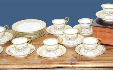 Twelve cups and saucers and six dessert plates...