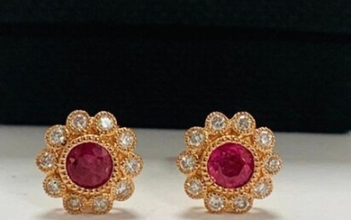 14ct Rose Gold Ruby and Diamond flower design stud earrings featuring centre, 2 round cut, pinkish red Rubies (0.60ct TSW), bezel set, with 20 round brilliant cut Diamonds (0.25ct TDW), mill-grain bezel set.