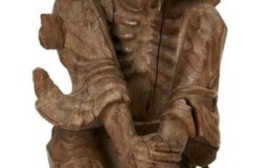 A Chinese carved wood figure of Li...