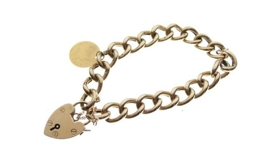 9ct gold curb-link bracelet with heart-shaped padlock and pierced...