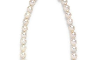 A 14 Karat Yellow Gold and Cultured South Sea Pearl