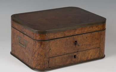 A 19th century Colonial burr walnut and brass bound campaign dressing box of curved rectangular form