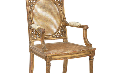 A 19th century French carved giltwood open armchair