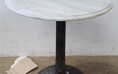 A CAST IRON BASE MARBLE TOP TABLE