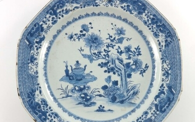 A Chinese export blue and white plate, painted with a floral...