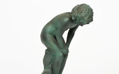 A Doulton stoneware figure of a boy designed by John Broad, modelled crouching and looking down to the ground, glazed green impressed Doulton to base, chip to back of base, 48cm. high Provenance The collection of Pam and Mark Taylor.