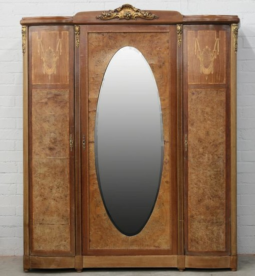 A French gilt bronze and inlaid burlwood armoire