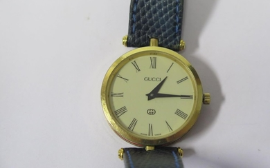 A GUCCI Gold Plated Wristwatch with red and green enamel ban...