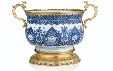 A NORTH EUROPEAN ORMOLU-MOUNTED CHINESE BLUE-AND-WHITE PORCELAIN CACHE-POT, THE PORCELAIN KANGXI (1662-1722), THE MOUNTS POSSIBLY EARLY 18TH CENTURY