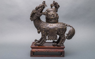 "A Rare Patinated Bronze ""Qilin"" Incense Burner and Cover on Wooden Stand, Inlaid with Stones, Late Ming Dynasty."