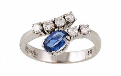 A SAPPHIRE AND DIAMOND DRESS RING, oval cut sapphire of appr...