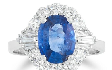 A SAPPHIRE AND DIAMOND DRESS RING set with an oval