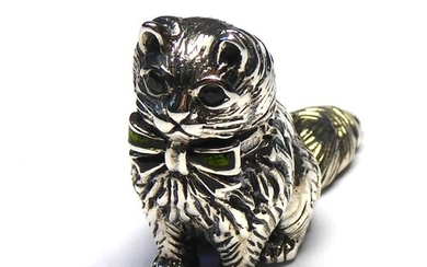 A STERLING SILVER NOVELTY MODEL OF A CAT Seated pose with gl...