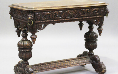A Victorian Baroque Revival carved oak centre table, fitted with a single frieze drawer, raised on c