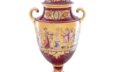 A Vienna Style Painted and Parcel Gilt Porcelain Covered Urn