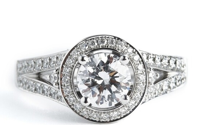 A diamond ring set with a brilliant-cut diamond weighing app. 1.12 ct. and brilliant-cut diamonds...