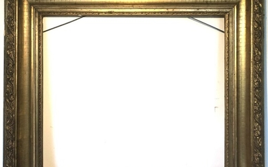 A late 19th century giltwood frame. Visible size 59×66 cm. Frame size 81×88 cm.