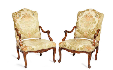 A pair of 18th century French provincial Louis XV solid walnut fauteuils