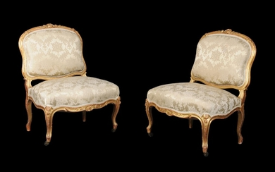 A pair of French carved giltwood low chairs in Louis XV style