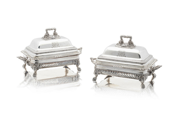 A pair of George III silver entrée dishes on Old Sheffield plate stands