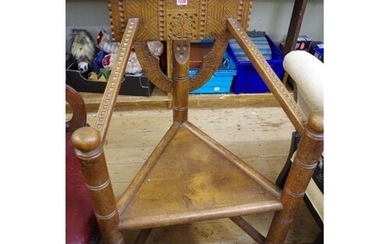 A pair of carved oak Turner's chairs.