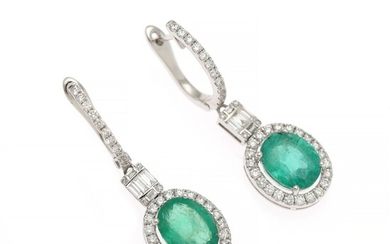 A pair of emerald and diamond ear pendants each set with an emerald weighing app. 3.25 ct. and diamonds weighing app. 0.85 ct., mounted in white gold.