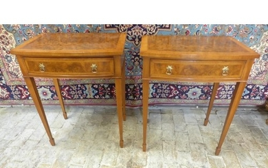 A pair of walnut bow fronted lamp tables, each with a frieze...