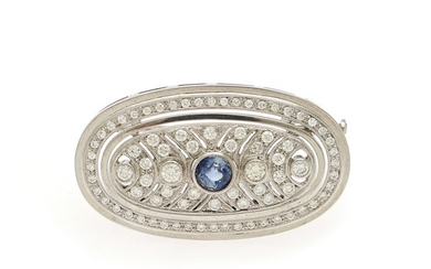 A sapphire and diamond brooch set with a circular-cut sapphire and numerous brilliant-cut diamonds, mounted in 18k white gold. L. app. 3.9 cm.